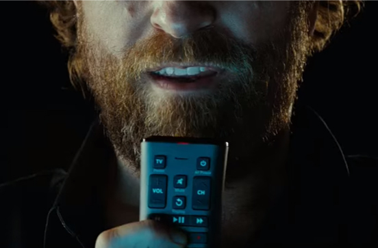 Man speaking into a remote