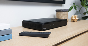 Cox HD receiver equipment sitting on a credenza with remote
